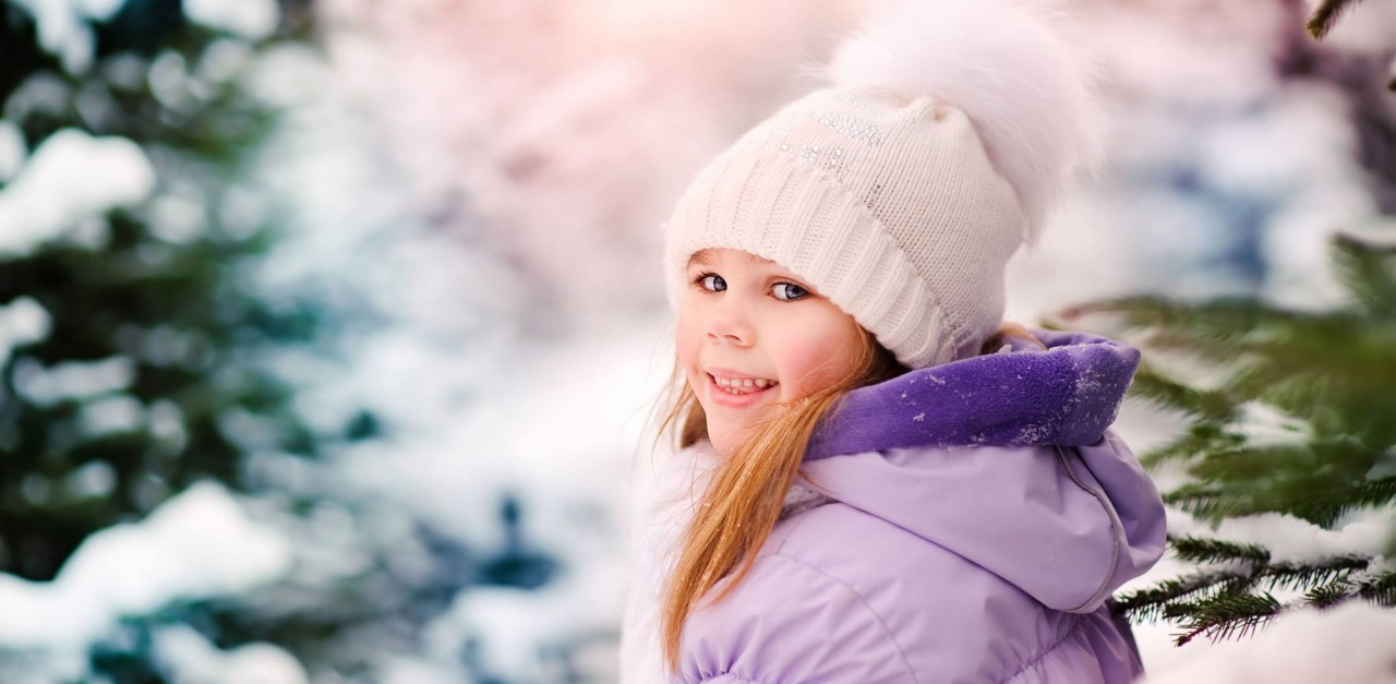 Child on winter holiday in Flachau