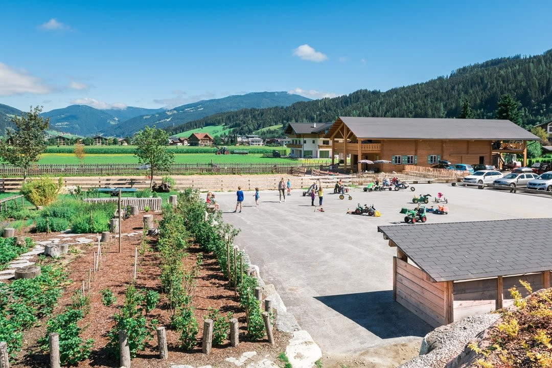 Outdoor area with view of go-kart track, snack garden and private riding arena